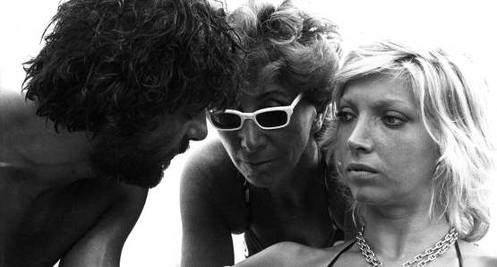 Lina Wertmüller with stars Giancarlo Giannini and Mariangela Melato on the set of SWEPT AWAY.