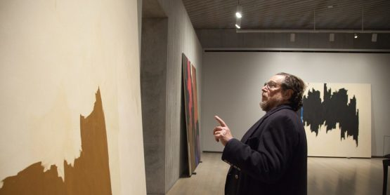 Julian Schnabel working at the Clyfford Still Museum in 2017, photo by Justin Wambold