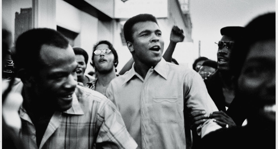 Muhammad Ali walks through the streets of New York City with members of the Black Panther Party in September 1970.