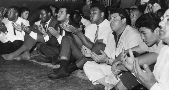Ali prays at the Hussein Mosque in Cairo in June 1964, four months after changing his name from Cassius Clay and announcing he is a member of the Nation of Islam.