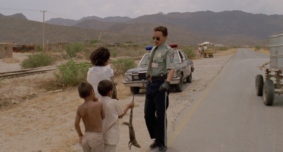 As the HIGHWAY PATROLMAN, Pedro (Roberto Sosa) must deal with all manner of infractions in Alex Cox's drama.