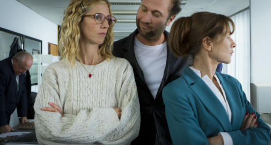 Sandrine Kiberlain as Sally Marinelli, François Damiens as Robert Mendès, and Isabelle Huppert as Esther Lafarge in TIP TOP, a film by Serge Bozon.