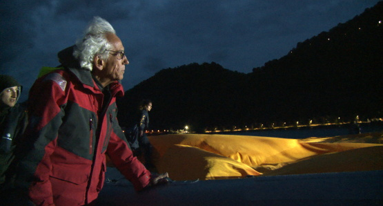 Christo in a scene from <i>Walking on Water</i>, courtesy Kino Lorber